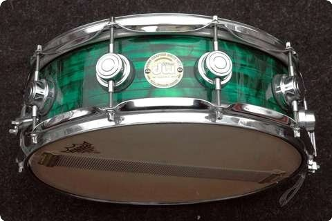 """Drum Workshop (DW) / DW Collectors 14"""" X 5"""" Snare In Green Pearl Finish / 2007. See more pictures on: www.vintageandrare.com/product/Drum-Workshop-DW-DW-Collectors-14-X-5-Snare-In-Green-Pearl-Finish-2007-Green-Pearl-Finish-30671"""