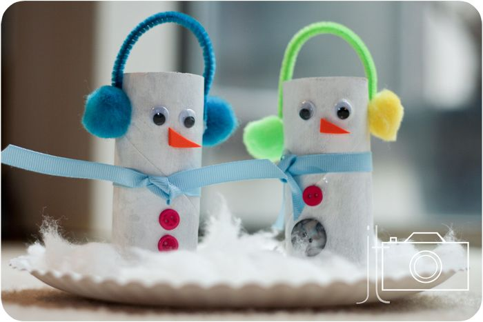Toilet paper tube snowmen with earmuffs made out of pipe cleaners and pom poms