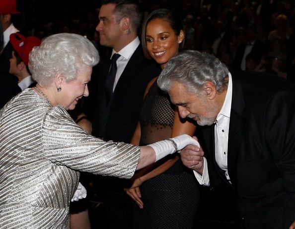 Queen Elizabeth has her hand kissed by Placido Domingo while attending the 2012 Royal Variety Performance at the Royal Albert Hall 19 Nov 2012