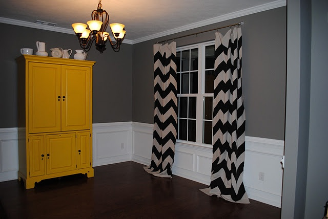Love these curtains and the gray walls and mustard armoire...