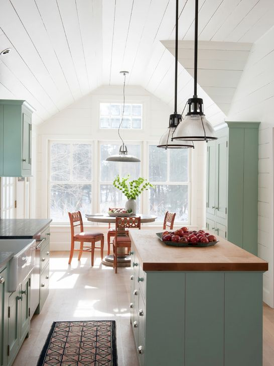 Cabinets painted with Farrow and Ball Green Blue No. 84. Shiplap walls painted with Moonlight White, Benjamin Moore. Maple butcher block island top. Pietra Cordosa stone countertops (like a combination of soapstone and slate).