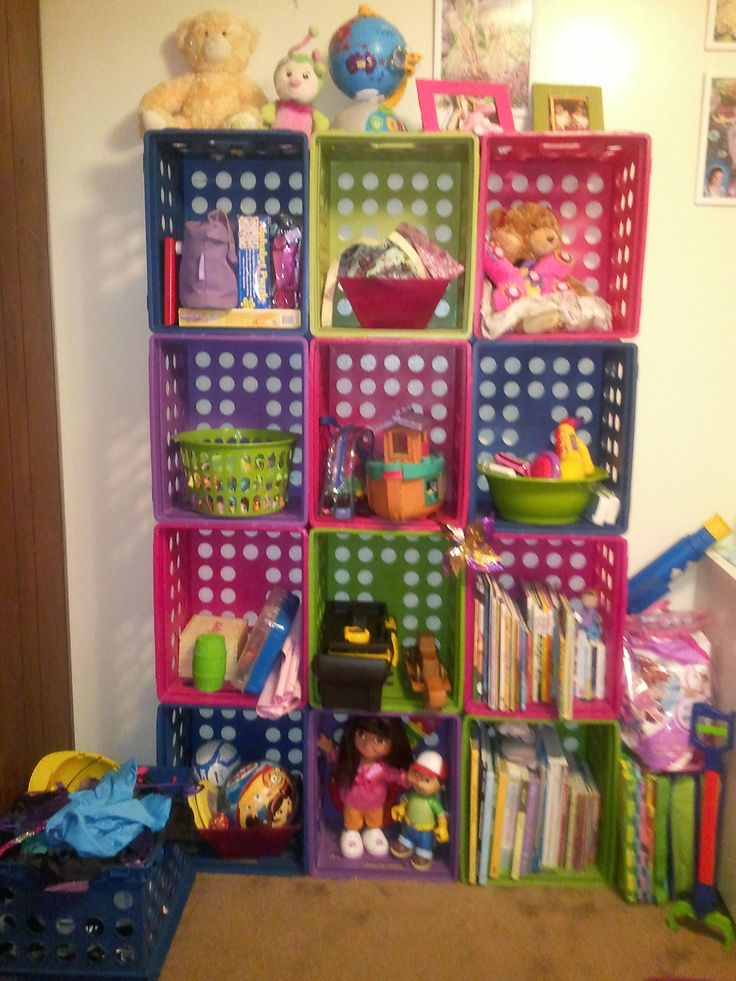 "colorful ""milk crates"" make great storage shelves for kids room"