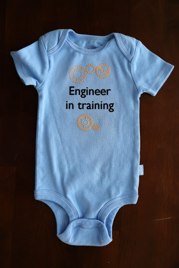 "heat transfer onsies :: from Playing it Cooley. Maybe ""electrician in training"" with a lightbulb?"