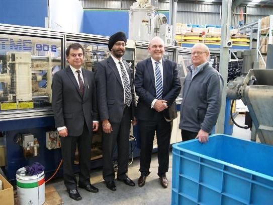 National MP's Kanwaljit Singh Bakshi and Steven Joyce with some of the Buteline team in the Buteline NZ factory in East Tamaki, Auckland.