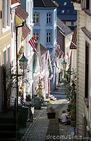 A narrow street of Bergen, some flags, long lens perspective.BEAUTY OF NORWAY COLLECTION »