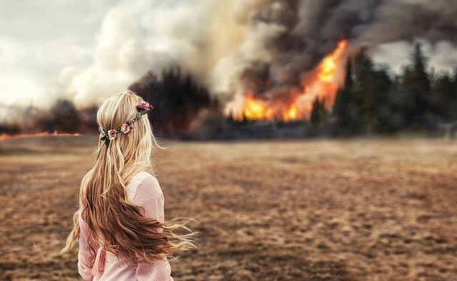 Wow... The softness of the flowers in her hair and her dress prove such contrast against the intensity of the fire.