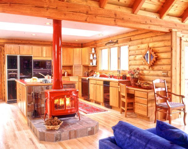 decoration stunning wood stoves in log cabins using metal stove beside wrought iron fireplace tools across natural stone cladding under kitchen island cabinets around oak flooring