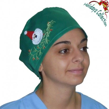 Scrub cap suitable for all medical purposes. This very cute scrub hat features handmade embroidered Christmas decoration with Santa's face!