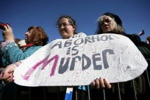 """Latest anti-choice strategy: Posters """"alerting"""" women they can't be forced to abort"""