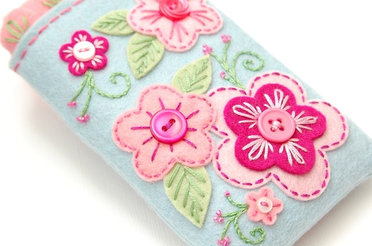 This is a phone case that I would definitely use!!  http://www.etsy.com/listing/51954327/gadget-cozy-pastel-garden#