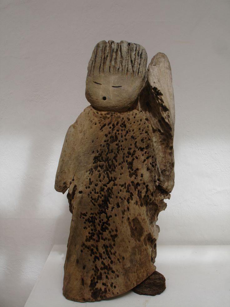 Querubin, Por Chila Trujillo, madera y piedra