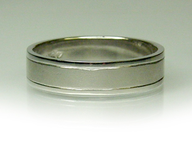 Chibnalls custom made 18ct white gold gents wedder with brushed finish center detail.