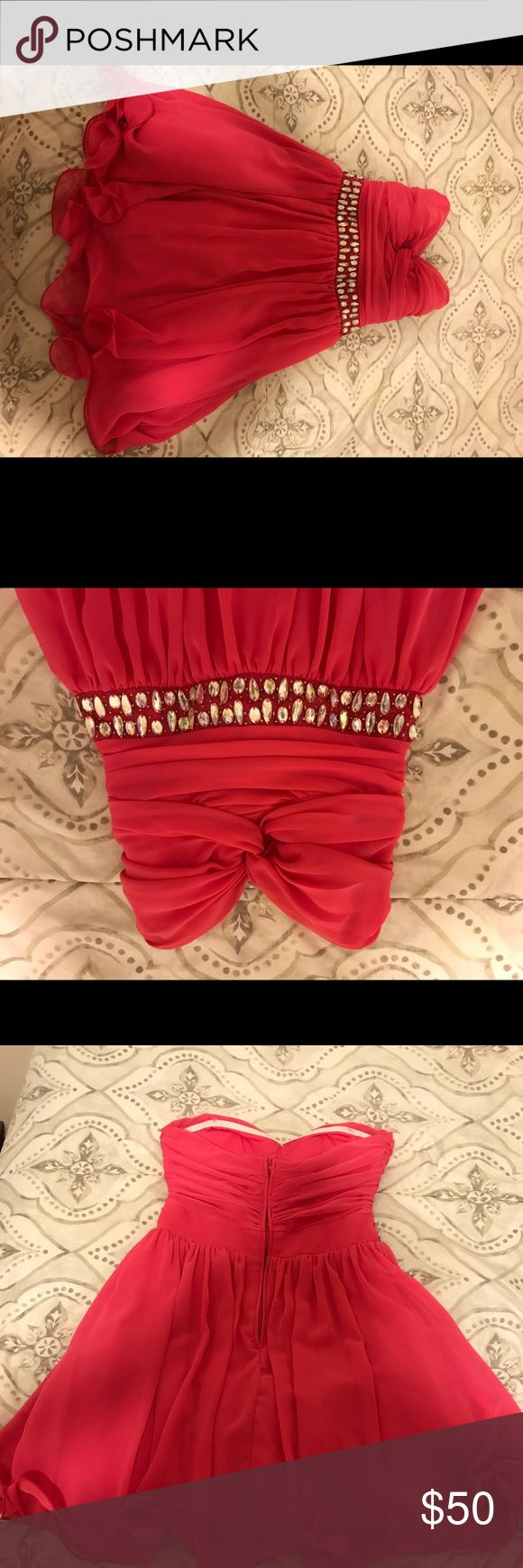 Pink B. Darlin dress with rhinestone belt Size 9/10 with a zipper back. No missing rhinestones on the front. Perfect for a formal/winter ball or school dance. Strapless but I did not experience any slipping. Very comfortable! B. Darlin Dresses Strapless