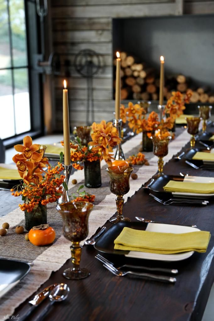 slimpaley.thanksgiving--I love doing Thanksgiving tablescapes a bit on the rustic side. Slim Paley hits all the right notes--color, threes, contemporary candlesticks and plate design--autumn colors, pumpkins...