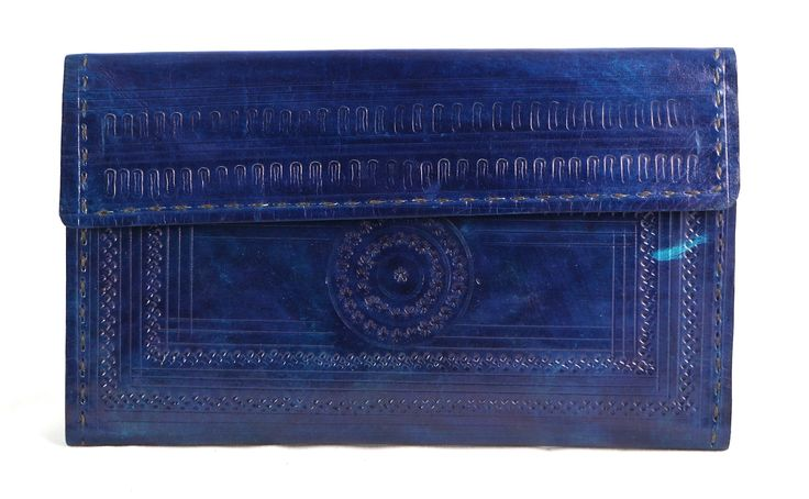 This Hand purse, women's Clutch is durable 3 fold, courtesy its leather make daily essentials with multiple card slots, 7 credit card slots. One for driving license. 1 extra photo window. 1 note compartment for currency. 2 chain compartment for Knick knacks. Secure mouth closure by a button.  #Buyhandbagsonline #HandmadeHandbags #Authenticdesignerhandbags #Womenswallets #Pursesonline #Handmadeitems #Styleincraft
