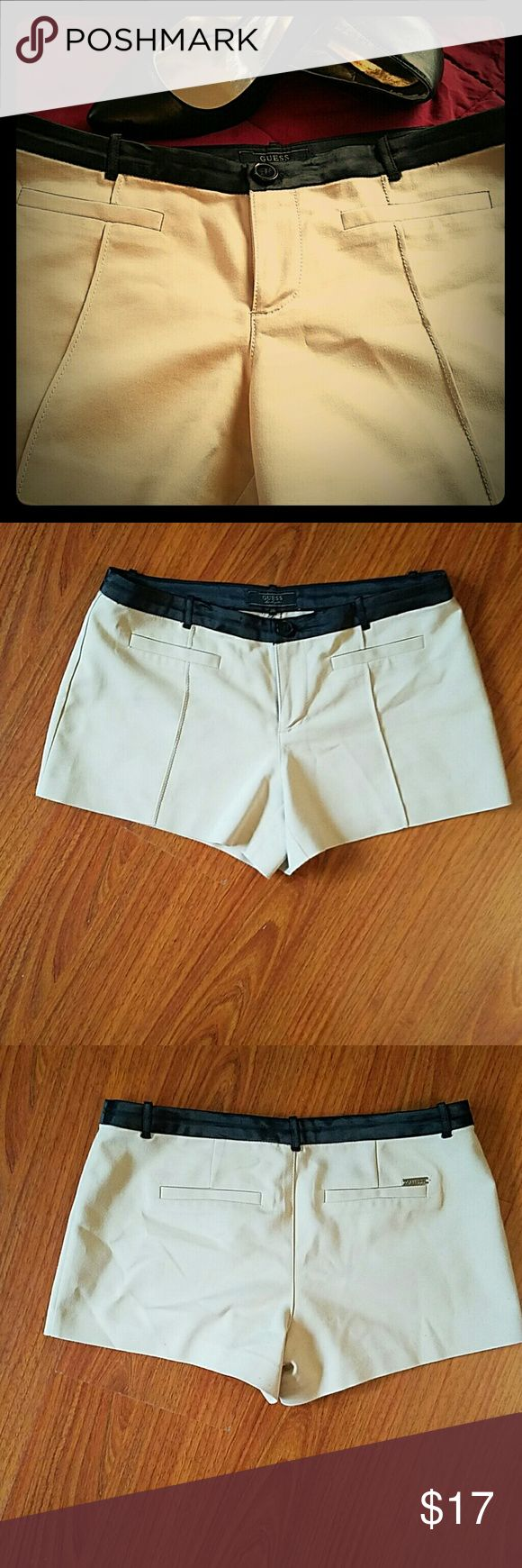 Guess shorts. Cute stretchy beige shorts with black trim around the waist. 49% cotton 48% polyester 3% spandex. Guess Shorts