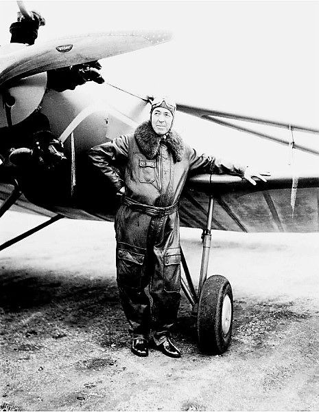 Edgar Rice Burroughs, noted author of the Tarzan series & Martian adventures, with his plane in Santa Monica, CA. Feb 3, 1934 [AP Photo]
