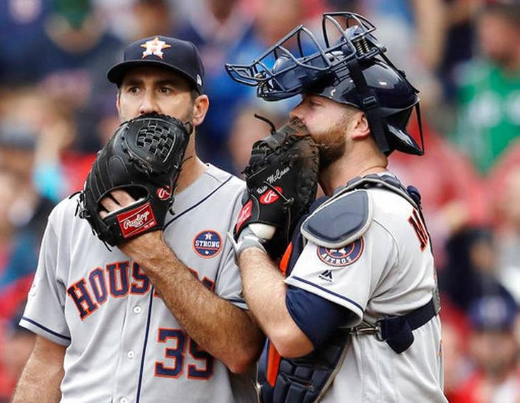 October 9, 2017:  Astros beat Red Sox 5-4 in Game 4, advance to ALCS  -  Houston Astros relief pitcher Justin Verlander, left, and catcher Brian McCann talk during the fifth inning of Game 4 of baseball's American League Division Series against the Boston Red Sox, Monday, Oct. 9, 2017, in Boston. Charles Krupa AP Photo