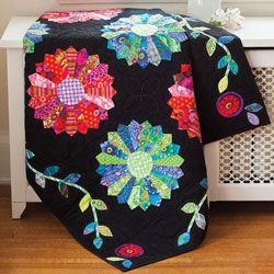 This stunning quilt creates a strong wow factor with bright and modern-print Dresden Plates placed into a traditional setting. A delightful appliqué border frames the quilt center. This quilt, Kaffes Garden at Night by Tonya Alexander, is fat-quarter friendly.