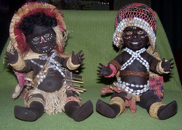 Metti dolls.    Beautiful head dress on the doll on the left.