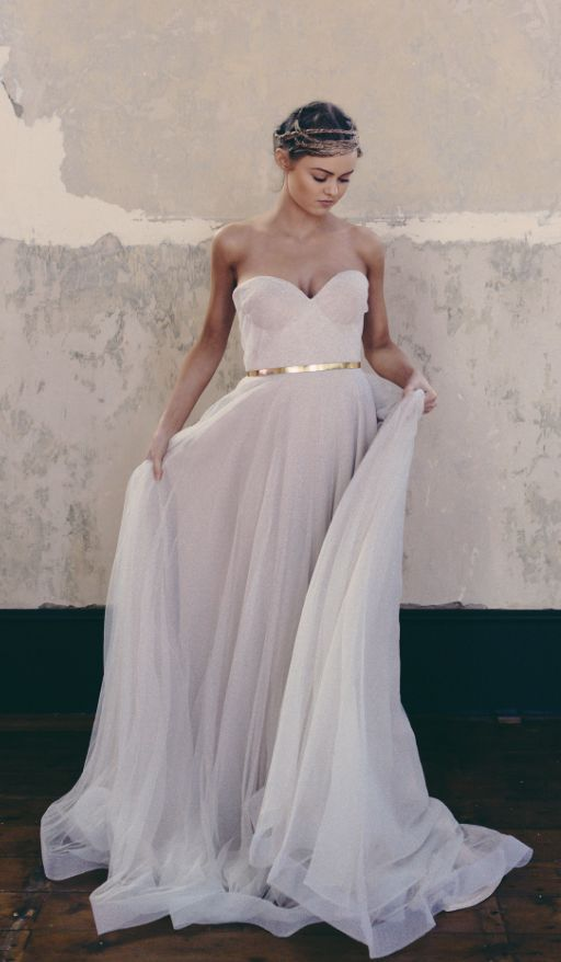 Elegant strapless sweetheart neckline wedding dress with gold belt detail; Featured Dress: One Day Bridal