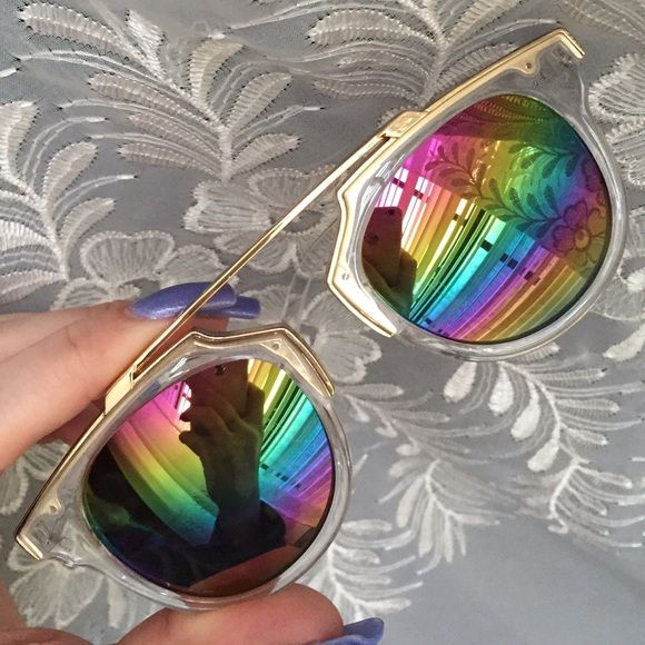 5792a1e5859 Clear frames with gold-tone trim. Approximately 5.75