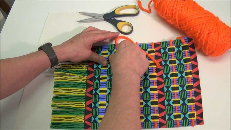 5:28 min. Kente cloth paper weaving... with black marker and paper strips... could be done on paper loom with strips added to the bottom of the short side..