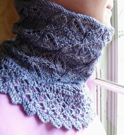 This neckwarmer in two sizes carries us through seasonal transitions by providing a chill-chasing layer without bulk. Knit in a crystalline cable-and-lace motif and finished with a knit-on border of lace snowflakes, this piece works up quickly on circular needles, travels well, and makes a beautiful gift.
