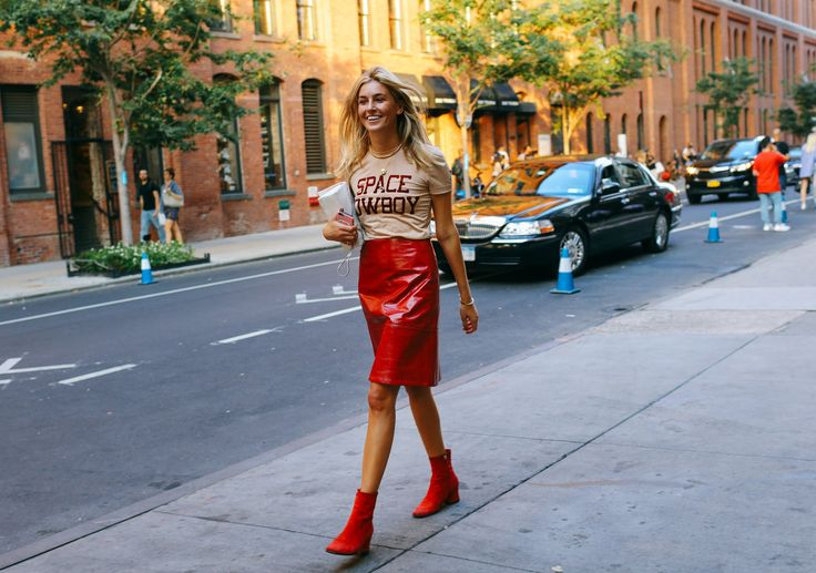 Camille Charrière in a Ganni t-shirt, Creatures of the Wind skirt, Dorateymur shoes, and 3.1 Phillip Lim bag
