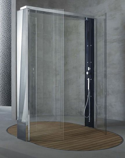 Accessible shower.  Floor drain through wood slats.  No grab bars, user could have a shower chair on wheels or fixed bench as needed.  By Megius