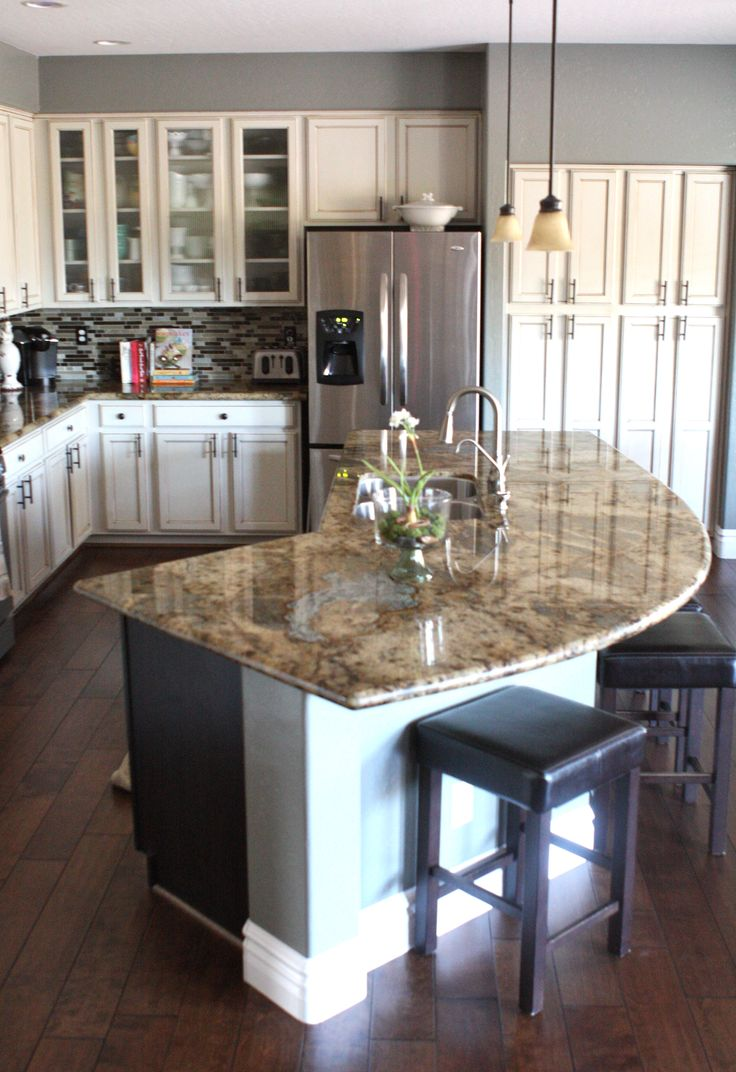 superb Kitchen Island Photos #5: The curved island might work for us. I like the color of the floors, the  granite, and think a cabinet like the tall one to the right of the u0027 ...