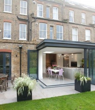 Don't like square block look of this, but like the way the bi-folding doors open out and leave the whole corner open