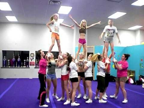 WATCH ALL: outside stunt groups prep assisted pull up middle stunt group to extension. Lib. Switch legs. Show-n-gos & fall back. Sit then back roll assist to prep. Extension. Twist down. Pencil roll. Cartwheel & backflip dismounts.
