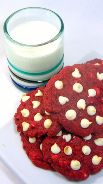 Red Velvet White Chocolate Cookies with SECRET INGREDIENT... The legendary cake recipe is adapted to a soon to be legendary cookie recipe! OH MY ARE THESE GREAT, soft and chewy with hints of so many tastes, tart from vinegar, chocolaty goodness and there is even a secret ingredient that puts the traditional frosting inside the cookie! I am talking REALLY REALLY GOOD!
