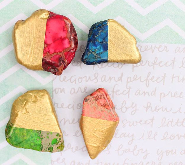 Class up your fridge lists by sticking them on with these painted pebble magnets. | 24 Gorgeous DIYs That Go For The Gold