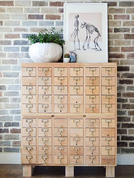 Mandi stripped the hardware with acetone, sanded all 58 drawer fronts, and replaced some trim. She had planned to sell the storage piece, but it sat in her garage for nine months. Then one day she brought it inside to replace the base, and now the revived card catalog stands proudly in her home.