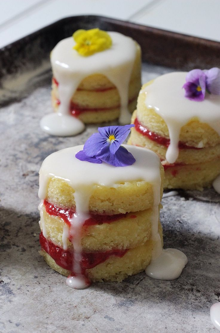 mini butter cakes are rich and almondy with a little almond flour, paste, and extract; filled with easy homemade strawberry preserves and an almond scented glaze