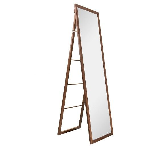 "• Made of glass and wood with a walnut finish<br>• Ladder back for hanging clothes<br>• Mounting hardware included<br><br>Transform your closet into a real wardrobe with the Walnut Wood Ladder Standing Mirror in Brown (20"" x 65"") from Threshold. This ladder-back mirror lets you see a full-length view of your outfit and organize your week's clothes."