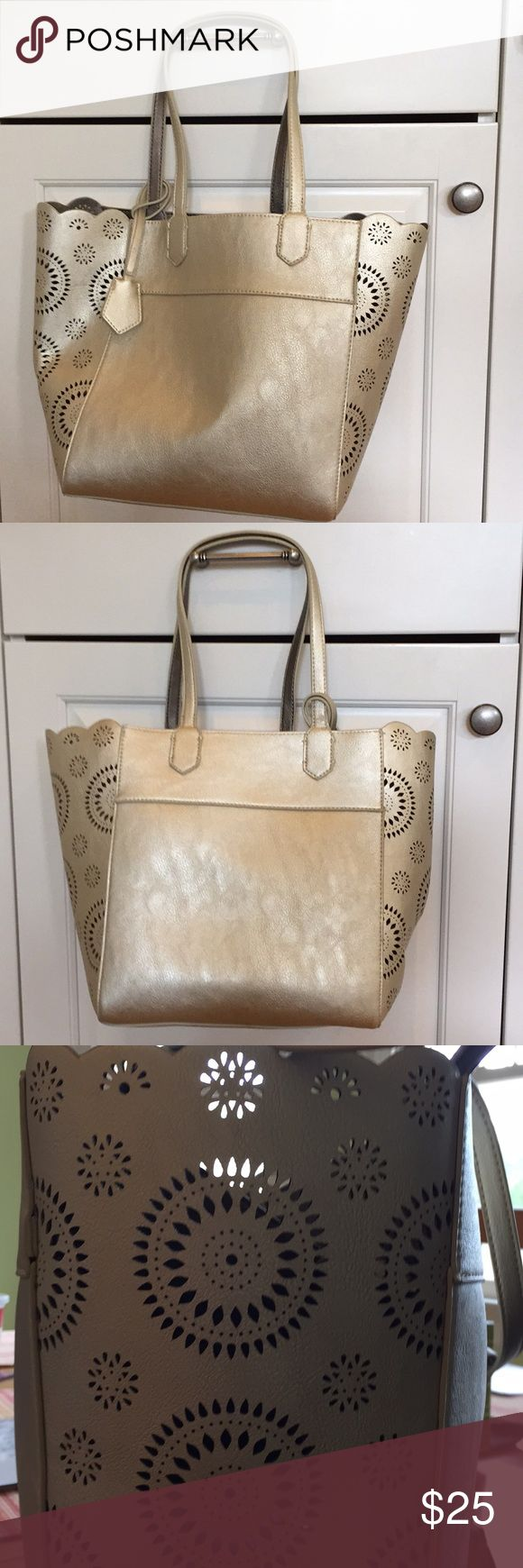 Anthropologie gold bag Super cute Anthropologie gold bag. Includes a zipper pouch inside. No zipper or other closure on top. Excellent condition. Never been used. Tags still on. Anthropologie Bags Hobos