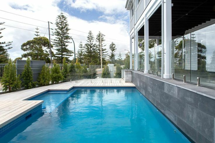 Sheer drop from alfresco into pool edged with treated timber.