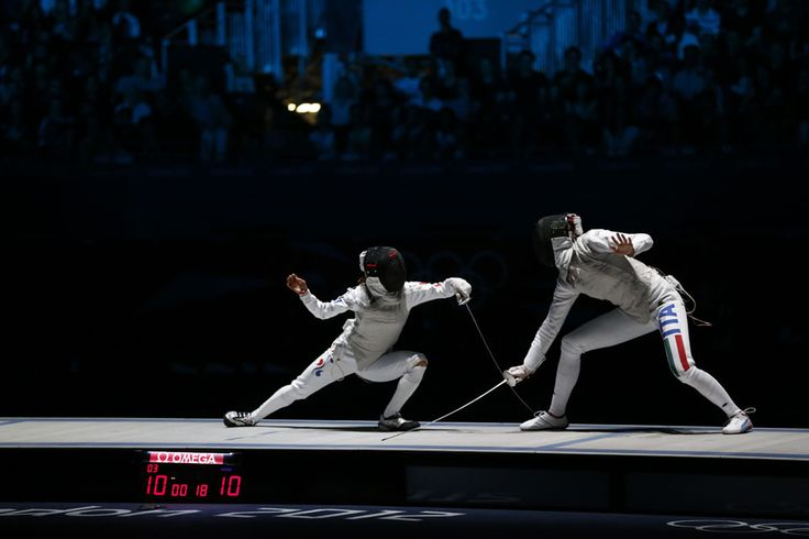 London 2012 - Veteran Italian fencer Valentina Vezzali parries Nam Hyun-hee of Korea and earns a bronze medal in the women's foil individual competition. Vezzali first medaled in this event with a silver at the 1996 Atlanta games, and went on to take gold in 2000, 2004, and 2008.    #olympics2012