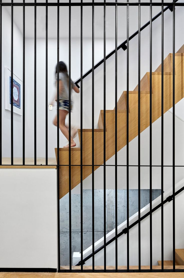 Steel, concrete, wood and white have been combined to create a contemporary staircase