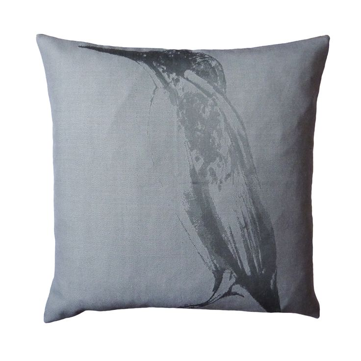 Iona Crawford's Kingfisher print has been uplifted into a light grey cotton. This cushion features the hand-drawn sketch on a contrasting weave, giving a sleek shimmer to the silhouetted design. The reverse of the cushion is made from a distinct interpretation of the Puffin Eye print. This cushion is multi-wearing and diverse in its design.  440mm x 440mm  100% cotton twill front and reverse.  Concealed zip closure.  Duck feather cushion pad.  Signature dust bag included.  Made in the UK.