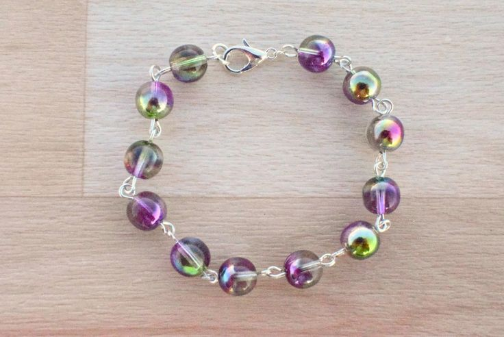 Purple Beaded Bracelet - Czech Glass Jewelry - Multi Color Bracelet - Beaded Link Bracelet - Glass Bead Jewelry - Custom Bracelet by SkadiJewelry on Etsy  This bracelet have magnificent Czech glass beads which are top quality and they have amazing color combination in shades of purple and lime green. Bracelet is nickel and lead free with lobster clasp.  #bracelet #braceletforwomen #everydaybracelet #etsyjewelry #multicolor #linkbracelet #czechglass #beadedbracelet #purple #limegreen