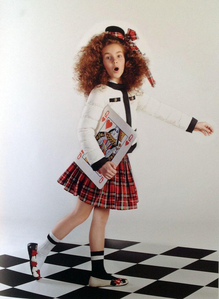 Wihite jacket, shirt and skirt by Moschino.
