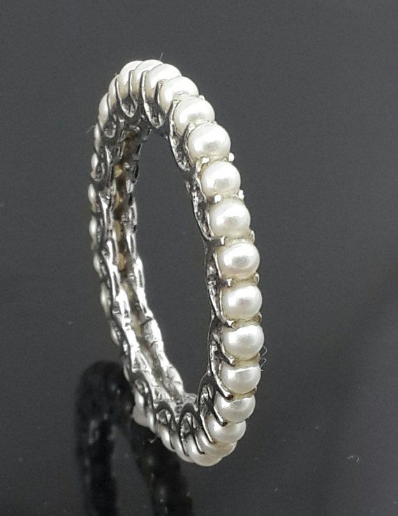 If you are born in June or you want a gift for someone special this is a perfect ring as pearl is the birth stone for June. and has many benefits of wearing it.   . 9ct white gold . eternity ring . Freshwater white pearls . slim line band . all sizes available . custom orders welcome Please allow 2 to 3 weeks for shipping as these are hand made jewelry.
