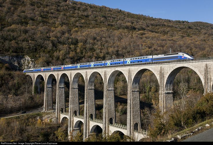 TGV 9773 Paris - Geneve is crossing the Cize Bolozon viaduct between Bourg-en-Bresse and Bellegarde.