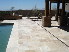 Use travertine tile for an instantly classic pool deck. #pools #pooldecks #travertine