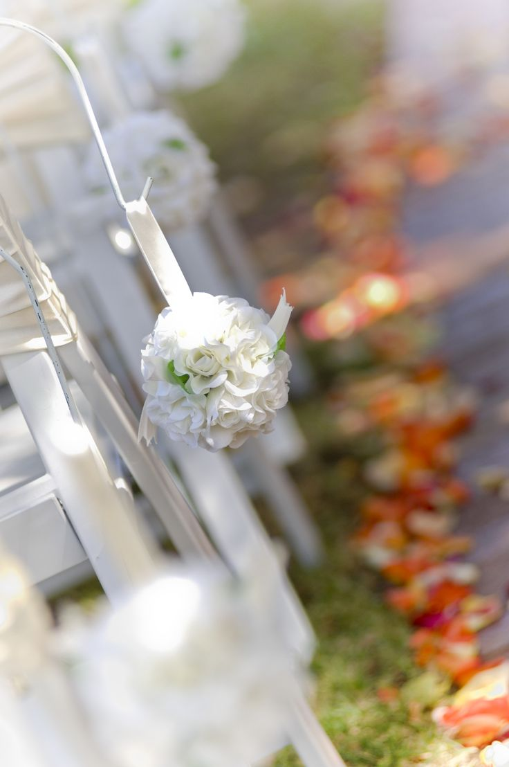 Rose petals add a hit of colour to your garden ceremony. If you are in lush greenery but maybe not in season for vibrant colour - here is your answer! - Joel Roosa Photography
