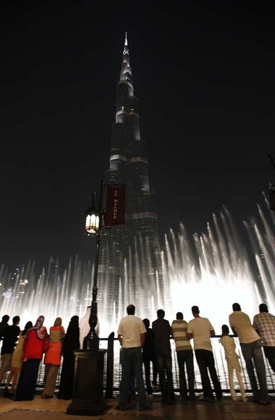 People watch a show at the musical fountain in front of the Burj Khalifa, the world's tallest tower, in Dubai.: Dubai Islamic Arabic, Follow Arif, Favorite Places, Arif Mirza, Dollar Business, Fountain, Facebook Fans, Fascinators Dubai, People Watches